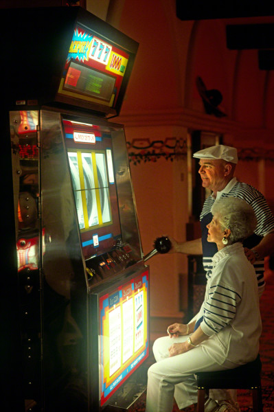 oldercoupleincasinoatbigslotmachine