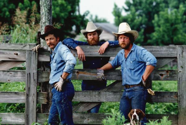 3cowboysstandingbyafence0203