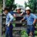 3cowboysstandingbyafence0203 thumbnail